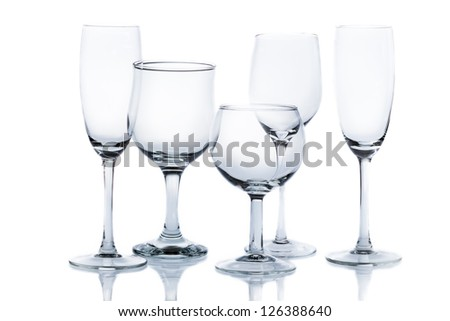 Different types of empty glasses on a white background