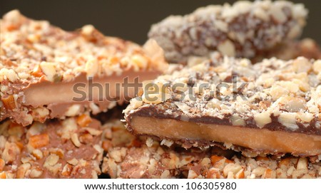 Different types of English Toffee with a variety of chocolates and nuts with a shallow depth of field. - stock photo