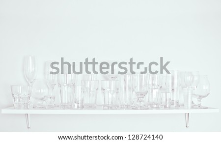 different types of glasses on the shelf - stock photo