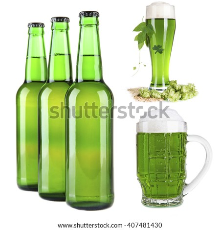 Different types of  green beer in glass, mug and bottles, isolated on white - stock photo