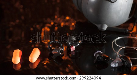 Different types of hearing protection for shooters with an orange background - stock photo