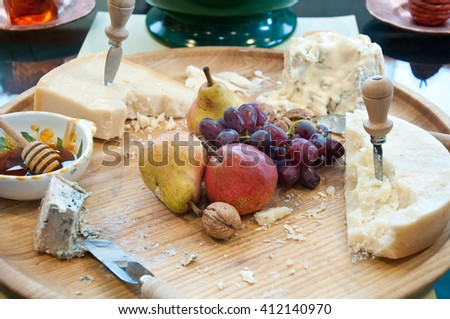 Different types of Italian cheeses served with honey and fruits,italy - stock photo