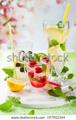 Different types of  Lemonade with berries and fruits - stock photo