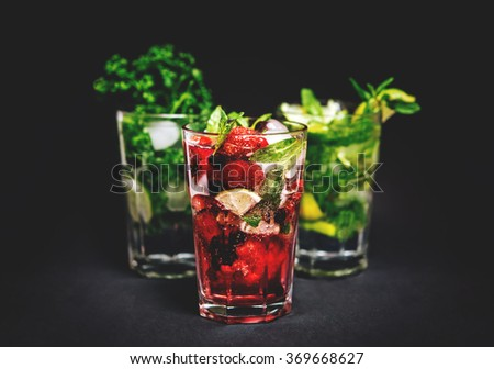 Different types of mojito cocktail on dark background. Toned picture