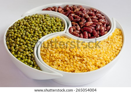 Different types of Multicolored beans in white ceramics bowl - stock photo
