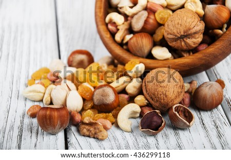 different types of nuts on a old wooden table - stock photo