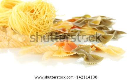 Different types of pasta isolated on white - stock photo