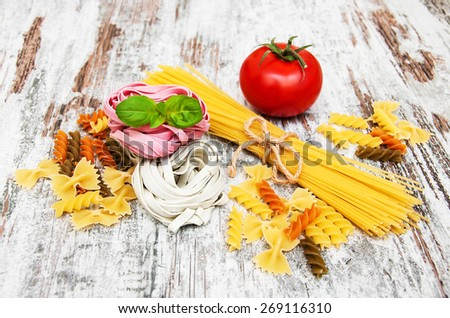 different types of pasta on a old wooden background - stock photo