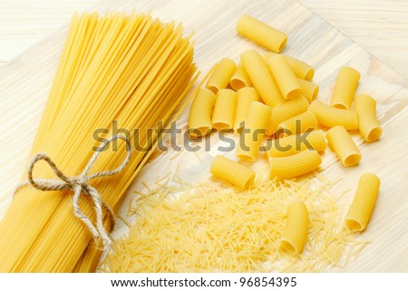 different types of raw pasta, noodle, spaghetti, on wooden table