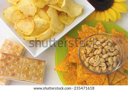 different types of snacks on the table - stock photo