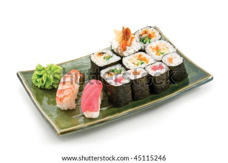 Different types of sushi in the plate isolated on white background - stock photo