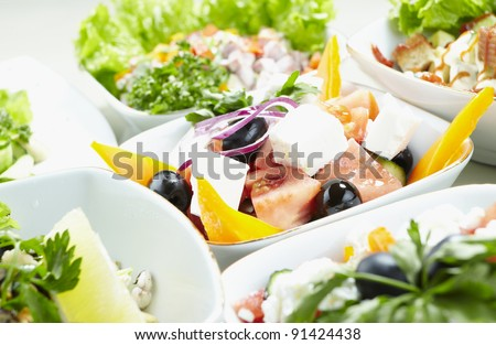 Different types of vegetable and seafood salads - stock photo