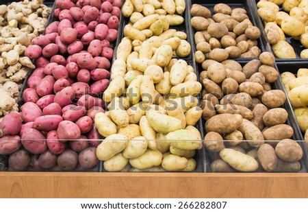Different varieties of potatoes in a shelf in a grocery store