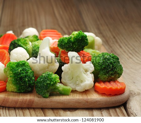 Different vegetables frozen on a cutting board - stock photo