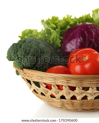 Different vegetables in basket isolated on white - stock photo