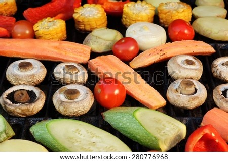 Different Vegetables Mix On The Hot BBQ Grill Background Overhead View - stock photo