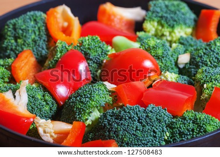 Different vegetables on pan.