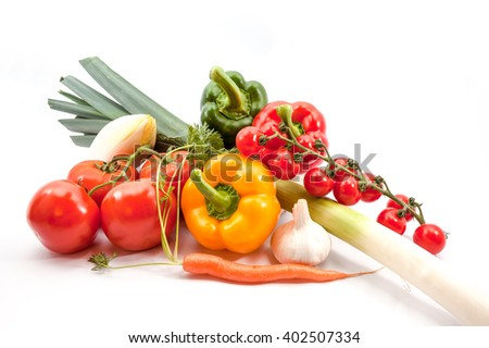 different vegetables such as carrots, leeks, tomatoes, peppers, chicory, garlic