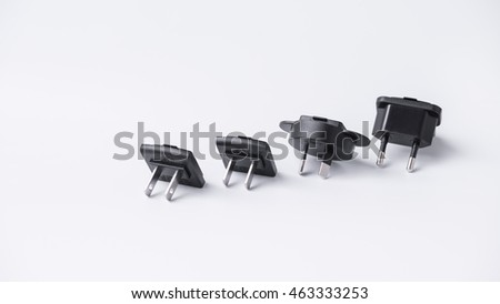 Different views of universal wall plug adapter. Isolated on white background. Slightly de-focused and close-up shot. Copy space.