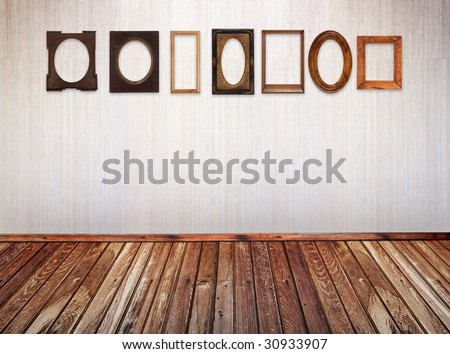 different vintage frames on wall - stock photo
