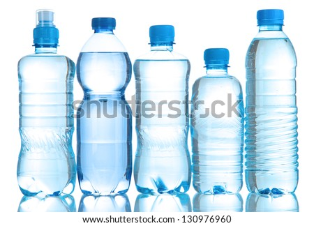 Different water bottles isolated on white - stock photo