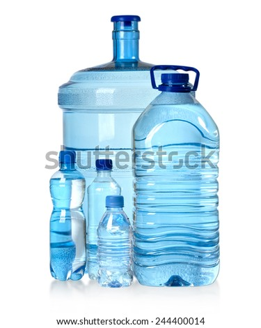 Different water bottles isolated on white with clipping path - stock photo