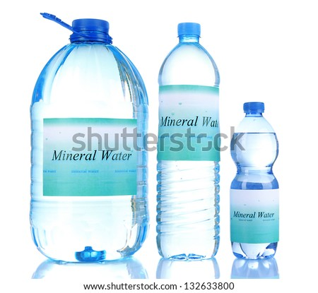 Different water bottles with label isolated on white - stock photo