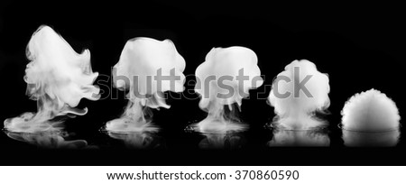 Different white smoke explosions isolated on black background - stock photo