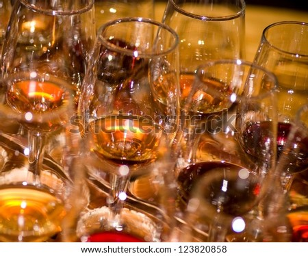 Different wine and glass on a dark background - stock photo