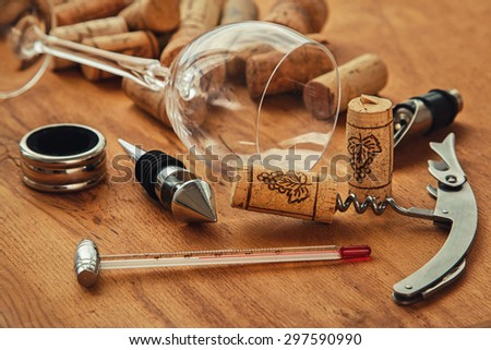 Different wine tools  on wooden surface - stock photo
