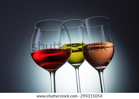 Different wine varieties (red, white and Rosé ) in wine glasses - stock photo