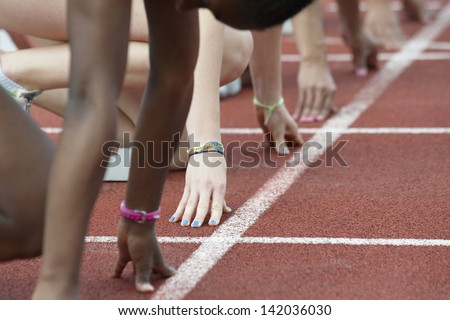 different woman's hands in the starting block - stock photo