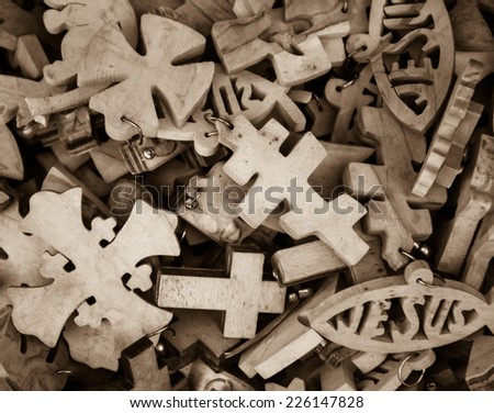 Different wooden crosses and Jesus fish symbol for sale at market in Old City of Jerusalem (Israel). Aged photo. Sepia. - stock photo
