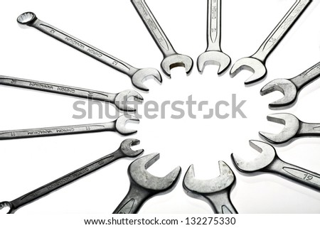 Different wrenches isolated on white, forming a circle. - stock photo