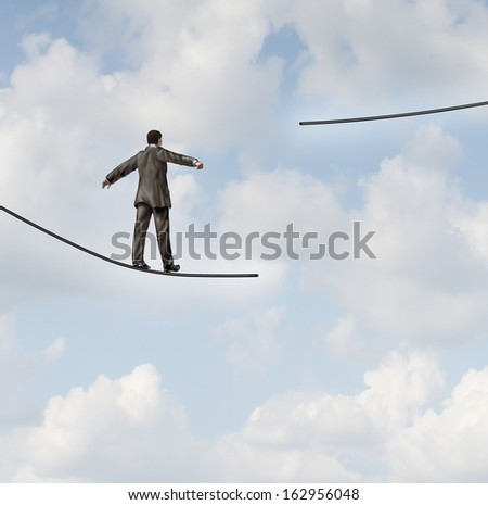 Difficult situation business concept with a businessman walking on a tightrope or high wire metaphor that has been cut and moved higher resulting in increased risk and danger to a planned strategy. - stock photo