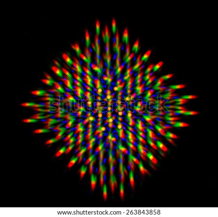 Diffraction of light from the LED array by the grating - stock photo