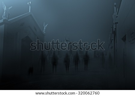 Diffuse entities walking on a street from an old European cemetery in moonlit night - stock photo