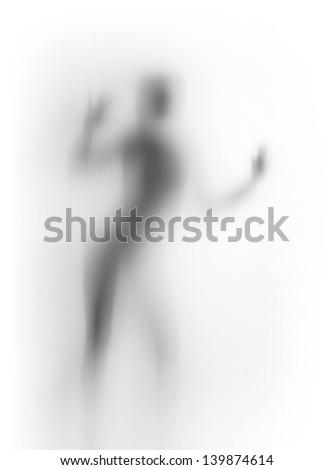 Diffuse silhouette of a dancing woman body