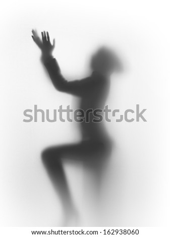 diffuse silhouette of a praying human