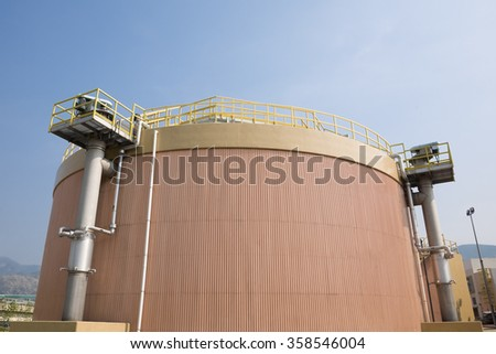 Digestion tank and heat exchanger in a sewage treatment plant - stock photo