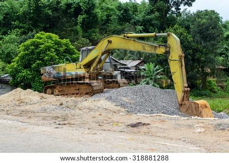 Digger excavator bucket bulldozer - stock photo