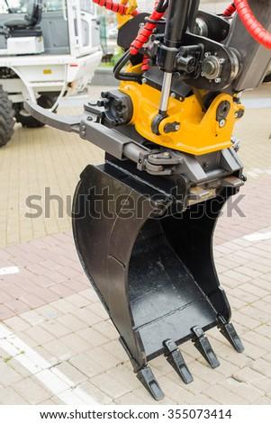 Digger excavator bucket bulldozer shovel industrial detail  - stock photo