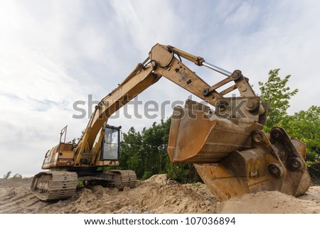 digger, heavy duty construction equipment parked at work site