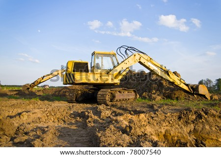digger, Heavy Duty construction equipment parked at work site - stock photo