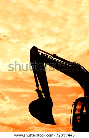 digger shovel under red sky