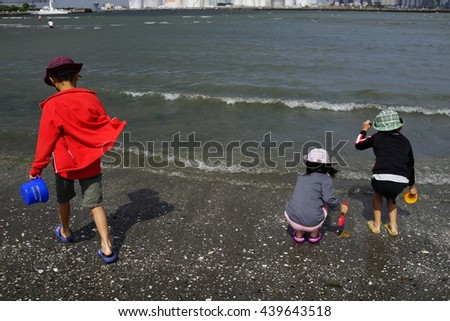 digging clams at the beach  - stock photo