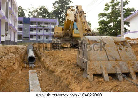 Digging drains to prevent flooding - stock photo