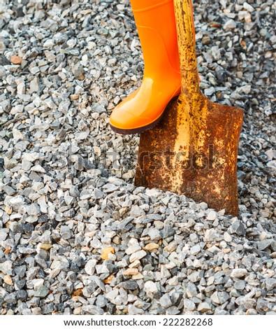 digging hard stone with shovel - stock photo