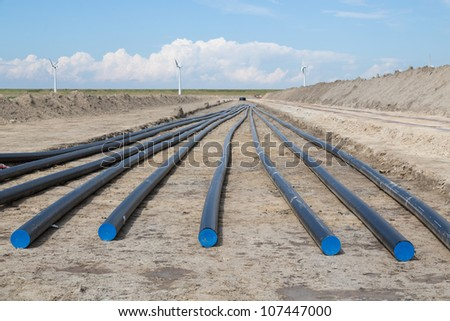Digging of a big electricity cable trench for a big new wind farm in the Netherlands - stock photo