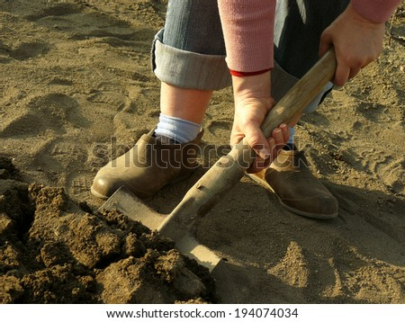 digging soil with shovel in a spring garden - stock photo